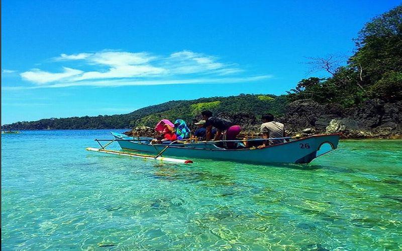 https: img-z.okeinfo.net content 2018 02 26 406 1864900 cantiknya-pantai-likupang-tempat-singgah-penyu-hijau-di-sulawesi-utara-4ekqEQKJNW.jpg
