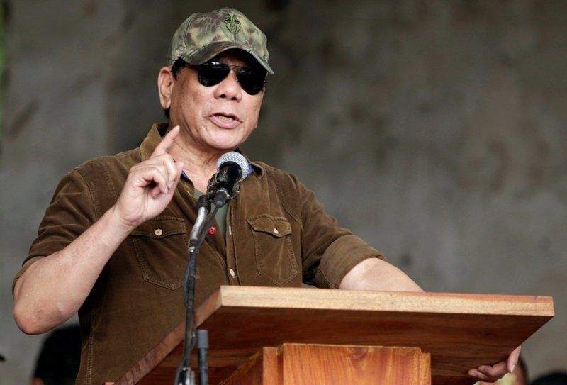 https: img-z.okeinfo.net content 2018 03 14 18 1872705 filipina-akan-keluar-dari-keanggotaan-mahkamah-kriminal-internasional-j6oJzW32Sx.JPG