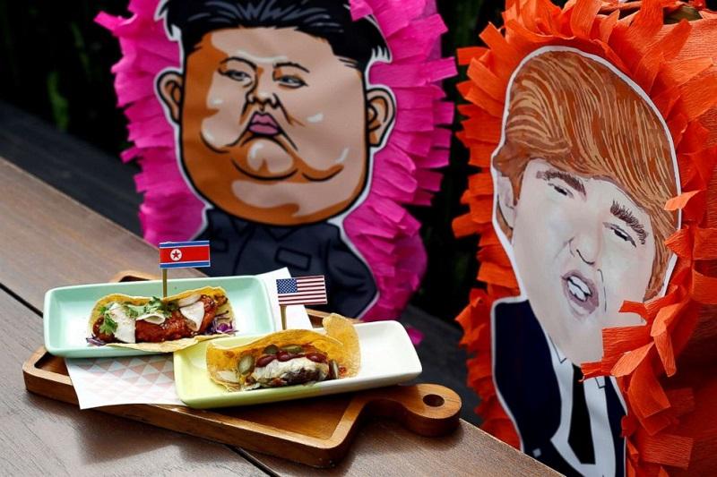 https: img-z.okeinfo.net content 2018 06 12 298 1909576 sambut-kedatangan-kim-jong-un-dan-trump-di-singapura-restoran-ini-buat-menu-burger-dan-tacos-bertema-kim-trump-ZMvaaq0mDp.jpg