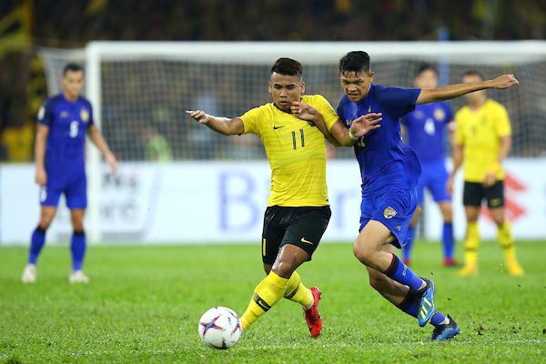 https: img-z.okeinfo.net content 2018 12 01 51 1985609 malaysia-tahan-imbang-thailand-di-leg-i-semifinal-piala-aff-2018-pp83WZgdvS.jpg