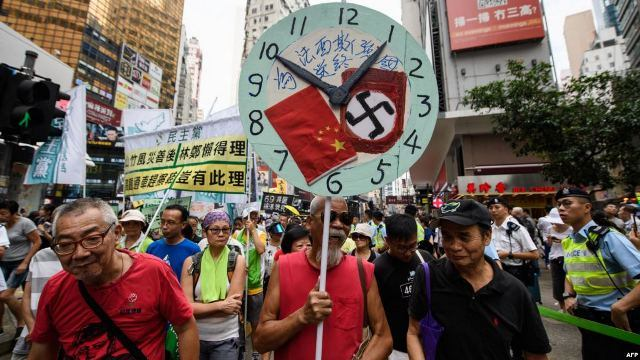 https: img-z.okeinfo.net content 2019 02 08 18 2015148 parlemen-hong-kong-bahas-ruu-hukuman-bagi-penghina-lagu-kebangsaan-5y1ZAVfLHJ.jpg