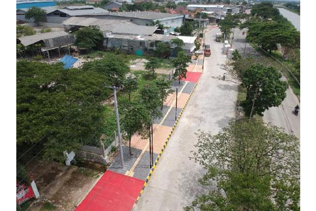 https: img-z.okeinfo.net content 2019 02 22 470 2021394 bekasi-bangun-trotoar-ramah-disabilitas-2v61aAll9L.jpg