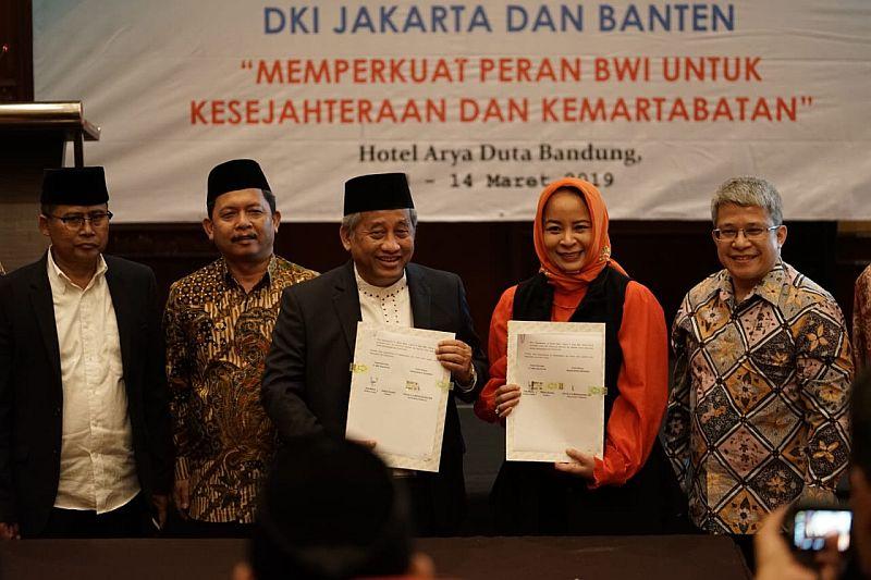 https: img-z.okeinfo.net content 2019 03 13 278 2029533 perluas-pasar-modal-syariah-mnc-sekuritas-gandeng-badan-wakaf-indonesia-2nFMlGa1nh.jpg