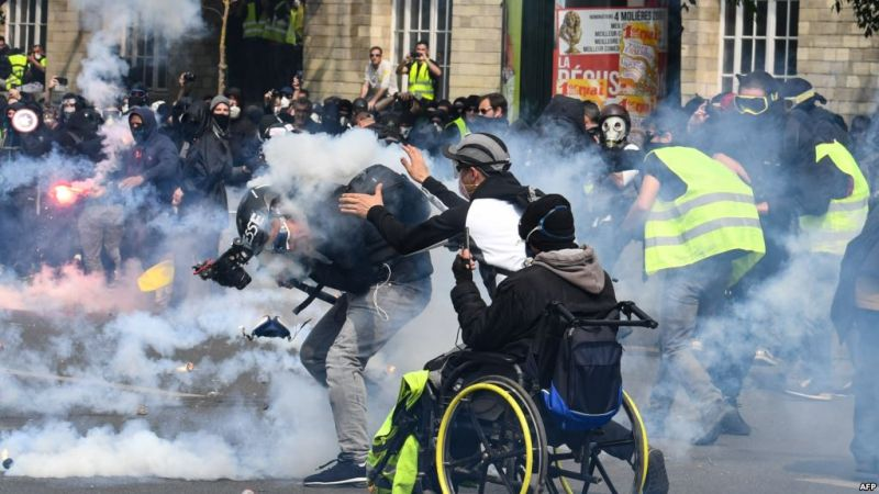 https: img-z.okeinfo.net content 2019 05 02 18 2050444 polisi-tembakan-gas-air-mata-ke-demonstran-may-day-di-paris-dlXB5jrO4g.jpg