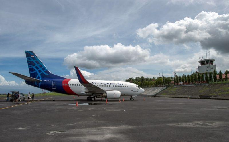 https: img-z.okeinfo.net content 2019 07 19 340 2080874 sriwijaya-air-batal-mendarat-di-bandara-supadio-gara-gara-kabut-asap-Ld5LJqD8gh.jpg