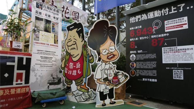 https: img-z.okeinfo.net content 2020 01 26 18 2158350 perayaan-imlek-di-hong-kong-yang-terbelah-pro-dan-antipemerintah-china-FH29skoWYg.jpg