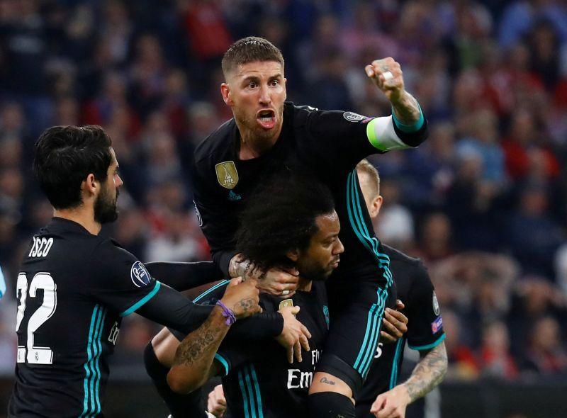 Pemain Real Madrid melakukan selebrasi