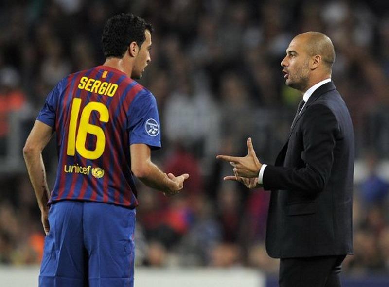 Sergio Busquet dan Josep Guardiola