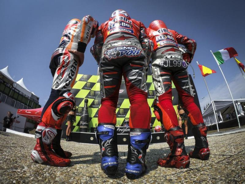 Marc Marquez, Andrea Dovizioso, dan Jorge Lorenzo (Foto: MotoGP)
