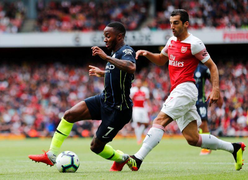 Raheem Sterling vs Henrikh Mkhitaryan (Foto: Reuters)