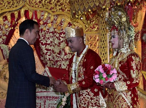 Jokowi hadiri pernikahan anggota paspampres Andhika Hartama Gedung Pelangi, Mako Paspampres, kawasan Tanah Abang, Jakarta Pusat, Minggu (9/9/2018). (Foto: Kris/Biro Pers Setpres)