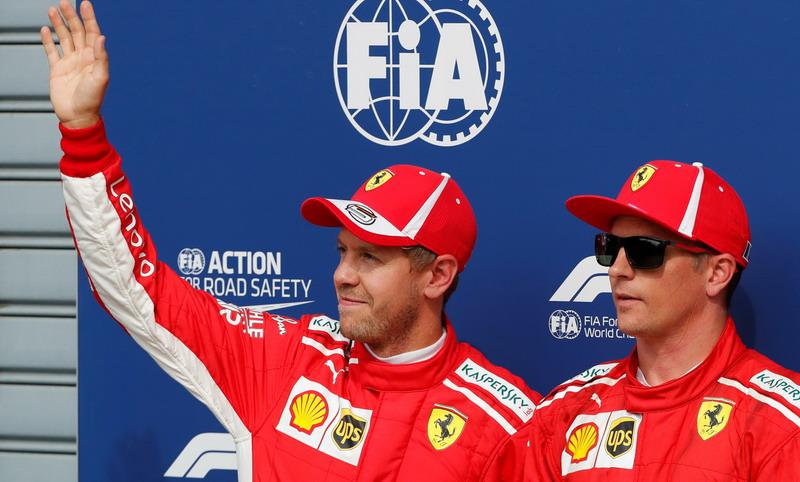 Sebastian Vettel dan Kimi Raikkonen (Foto: Reuters)