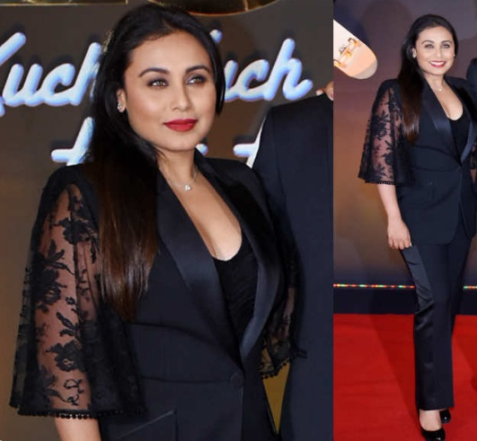 Rani terlihat stylish dalam balutan atasan renda seksi lalu di mix and match dengan blazer warna hitam
