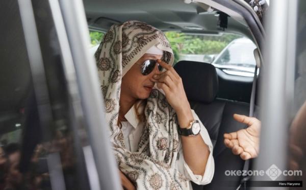 Habib Bahar saat menghadiri pemeriksaan di Bareskrim Polri. (Foto : Heru Haryono/Okezone)