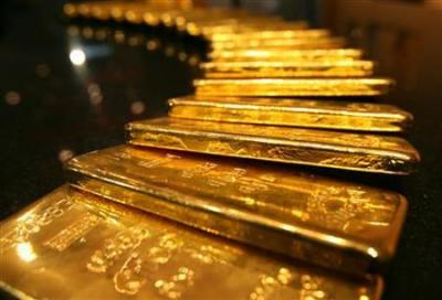 Harga Emas Tertekan Penguatan Dolar dan Pasar Saham AS