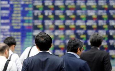 The Fed Tahan Suku Bunga, Wall Street Meroket