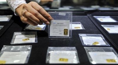 Harga Emas Antam Kembali Turun hingga Rp8.000 Gram