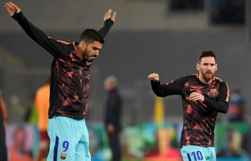 Luis Suarez dan Lionel Messi (Foto: AFP)