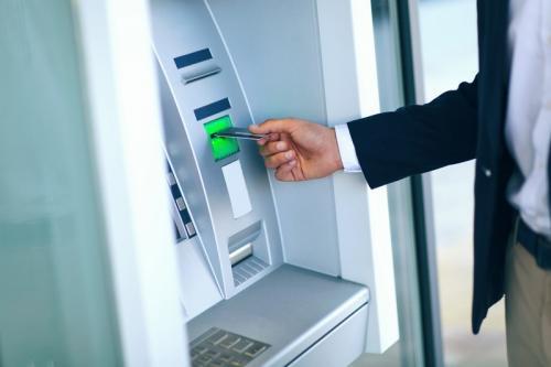 Ilustrasi mesin ATM. (Shutterstock)