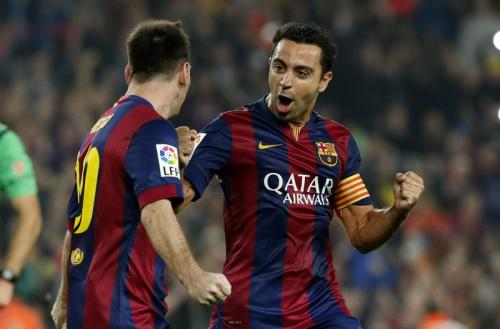 Lionel Messi dan Xavi
