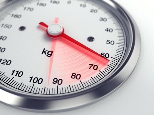 Ilustrasi timbangan dalam program diet