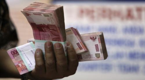 Ilustrasi uang hasil penipuan. (Foto: Okezone)
