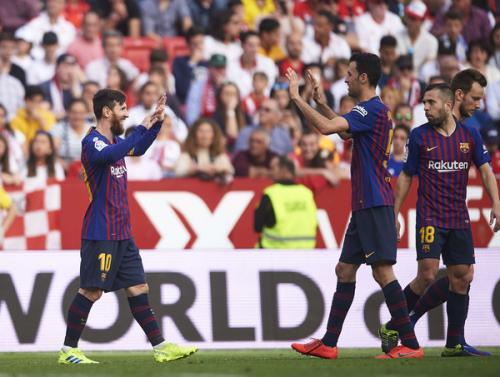 Messi  dan Busquets