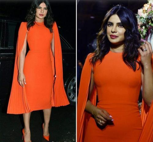 Perempuan pakai gaun oranye