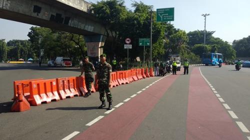 Jalan Medan Merdeka ditutup dampak sidang putusan MK. (Foto: Fadel Prayoga/Okezone)