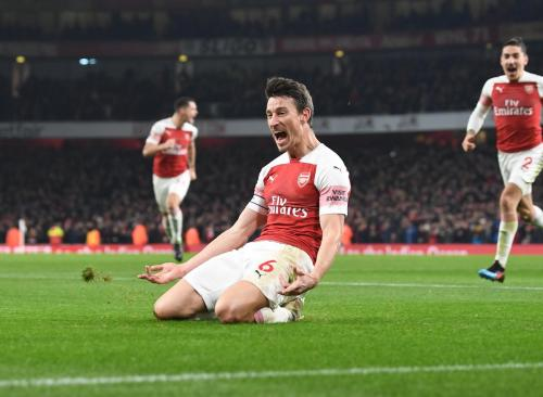 Aksi Laurent Koscielny saat sedang membela Arsenal