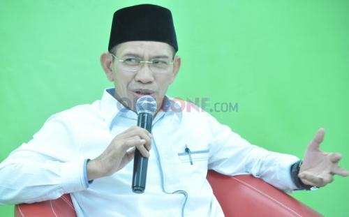 Ketua Harian Pengurus Besar Nahdlatul Ulama (PBNU), Robikin Emhas. (Okezone)