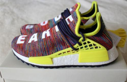 hypebeast NMD Human Race X Pharrell Williams keluaran Adidas warna fushia muda.