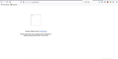 Tampilan background berwarna putih disertai permohonan maaf bahwa situs sedang proses maintenance.