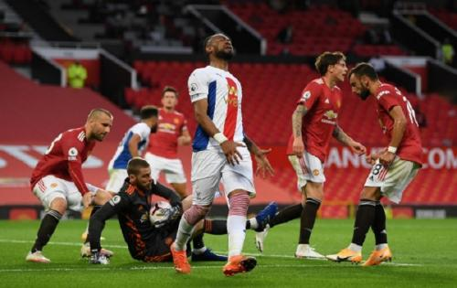 David de Gea mampu menepis eksekusi Jordan Ayew (Foto: Man United)