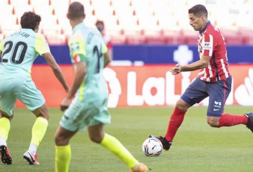 Aksi Suarez saat bermain bersama Atletico