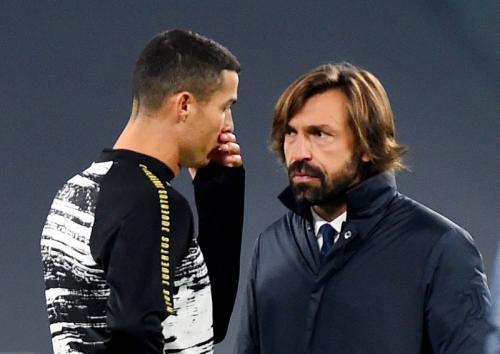 Cristiano Ronaldo dan Andrea Pirlo (Foto: Reuters)