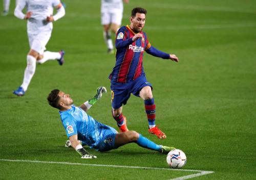 Aksi Lionel Messi saat bela Barcelona
