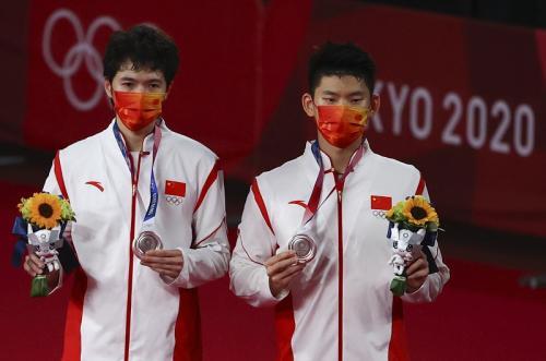 Atlet bulu tangkis China