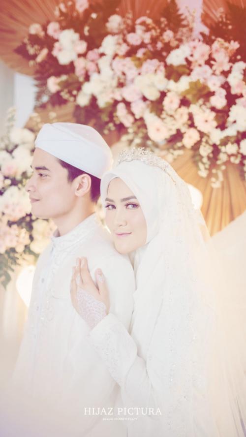 Alvin Faiz dan istri, Henny Yulia Rahman. (Foto: Instagram/@alvin_411)