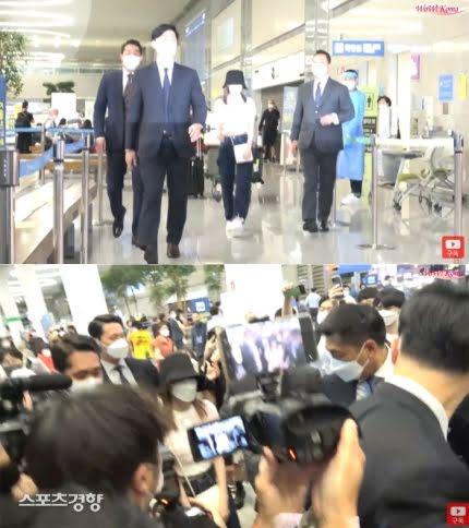 Miyawaki Sakura dapat pengawalan ketat saat tiba di Bandara Internasional Incheon, pada 27 Agustus 2021. (Foto: WoW Korea)