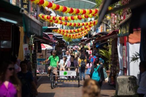 Wisata becak Uncle di Chinatown Singapura. (Foto: Singapore Tourism Board/Antara)